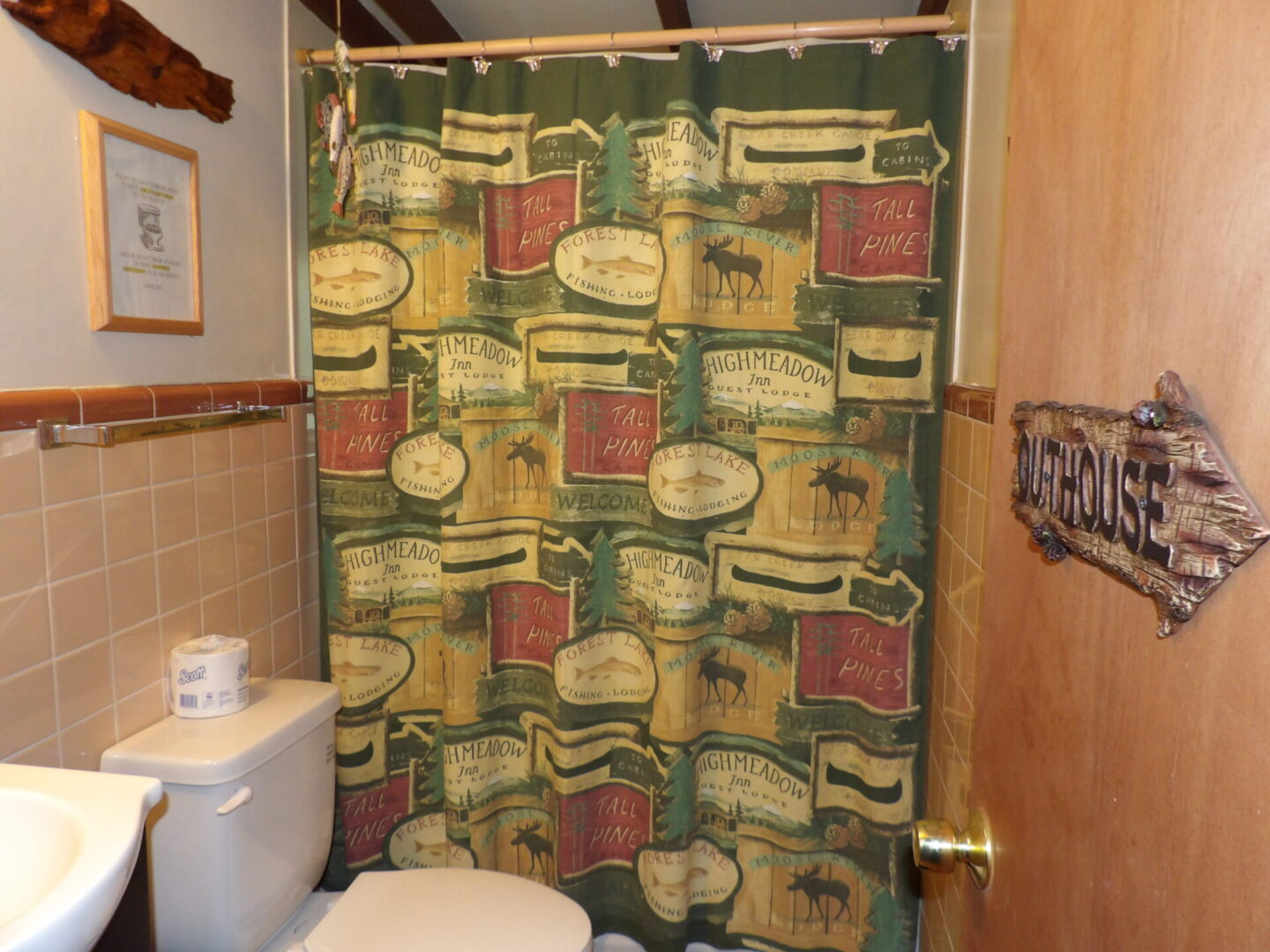 shower with moose-themed curtain