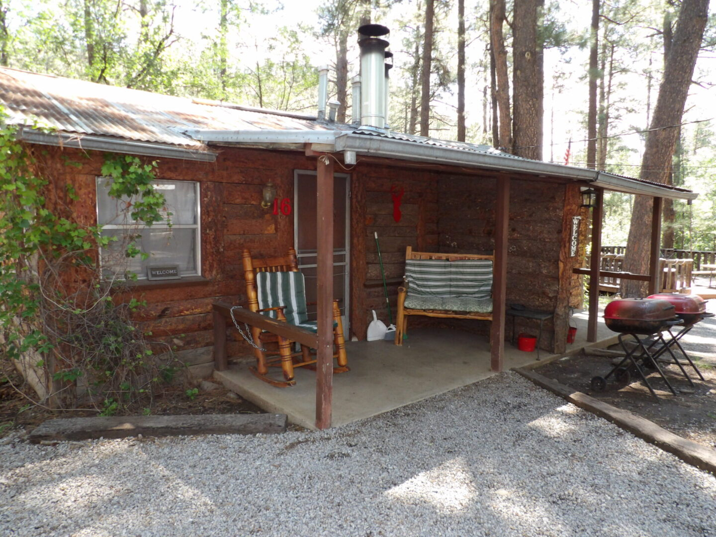 entrance to a cabin with chairs and grills