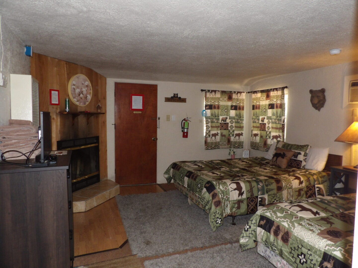 bedroom with two beds and a TV