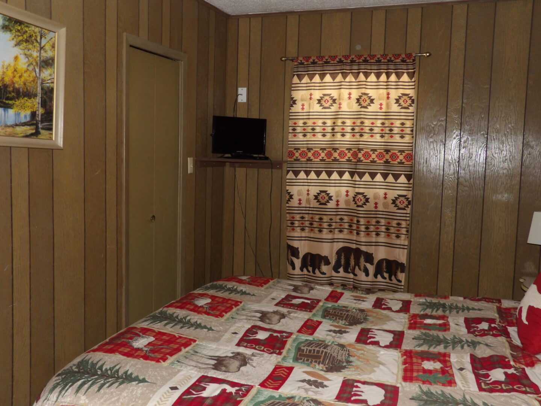 bedroom corner with TV