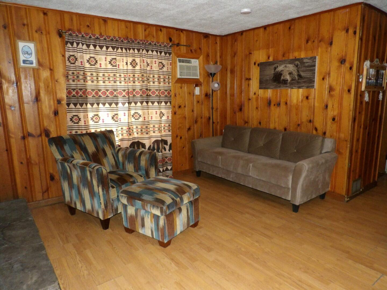 living room with three sofas
