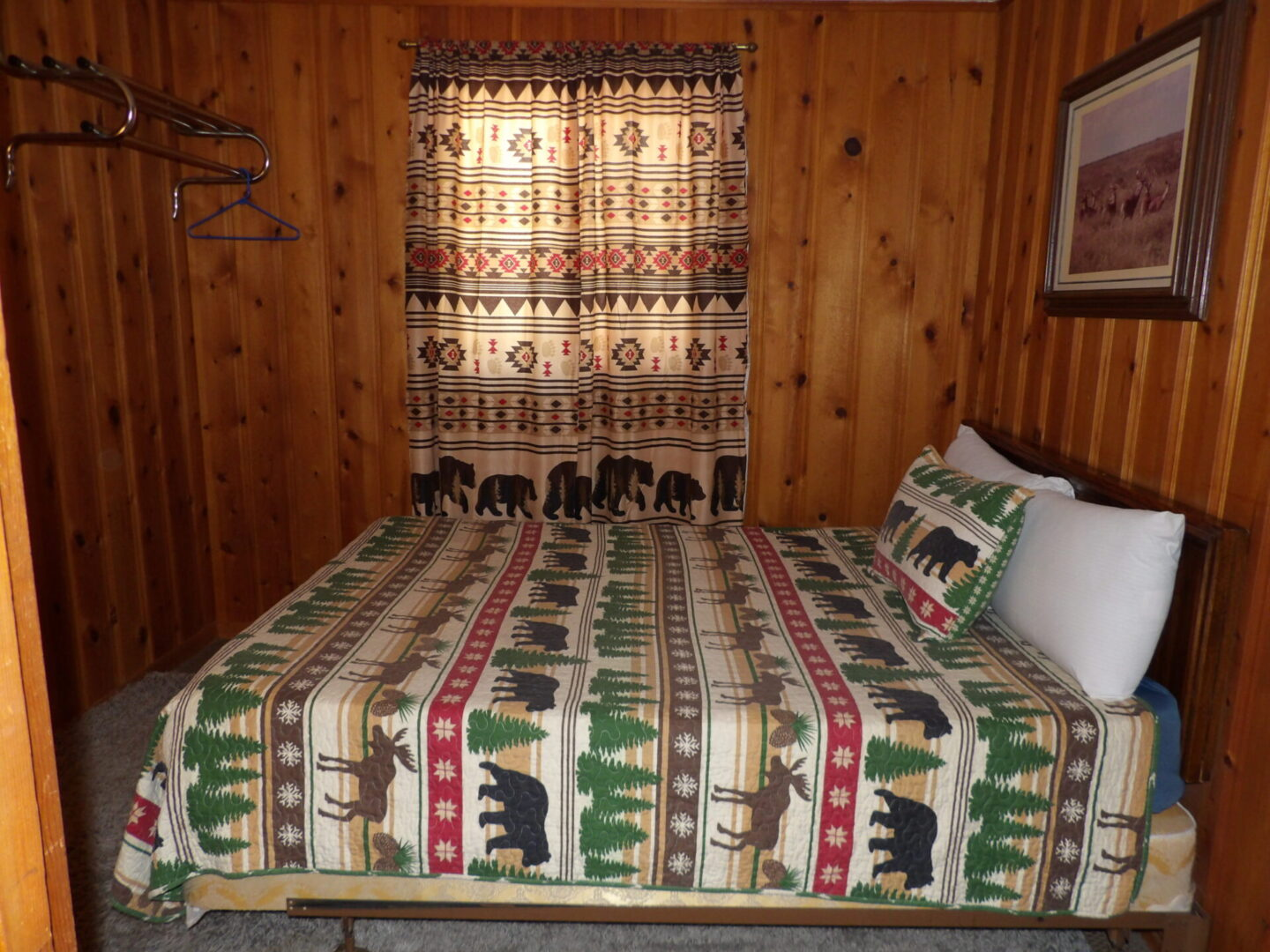 small bed with moose and bear themed design