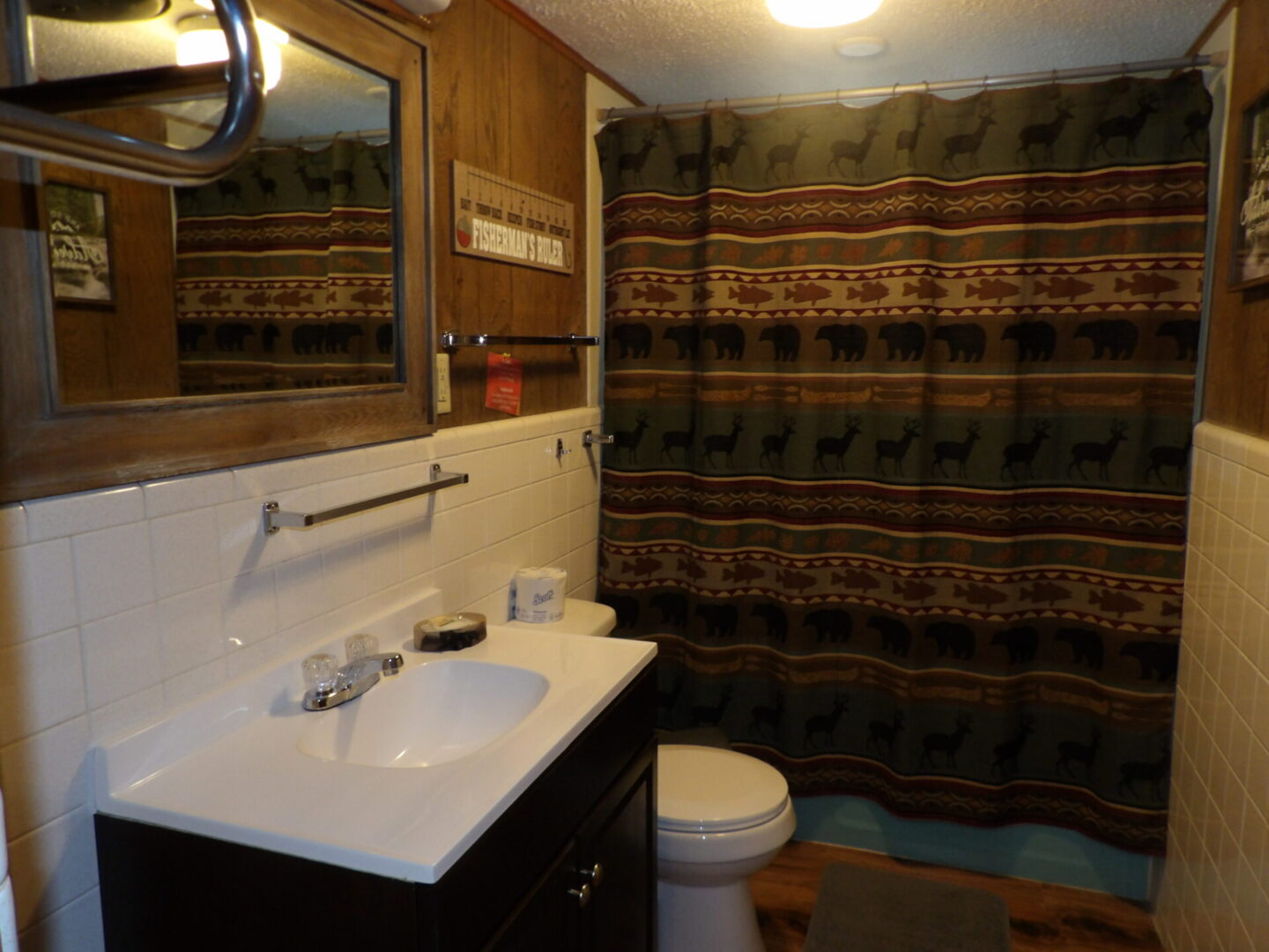 bathroom with forest-themed furnishing