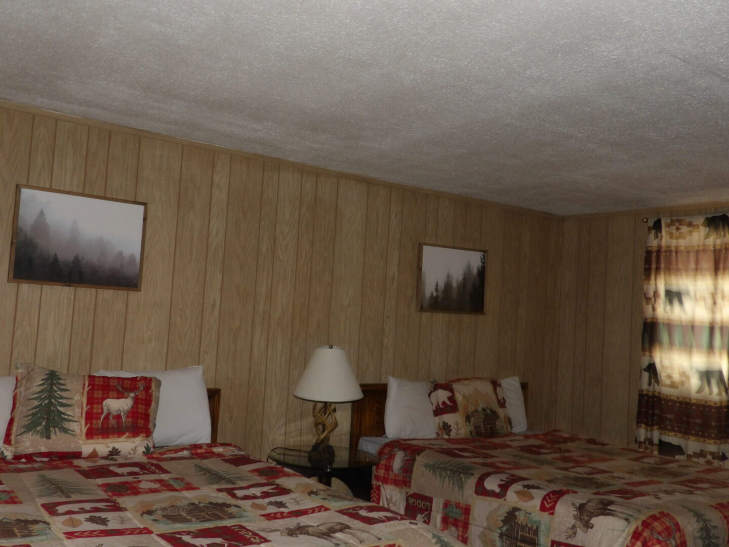 bedroom with two pine tree picture frames
