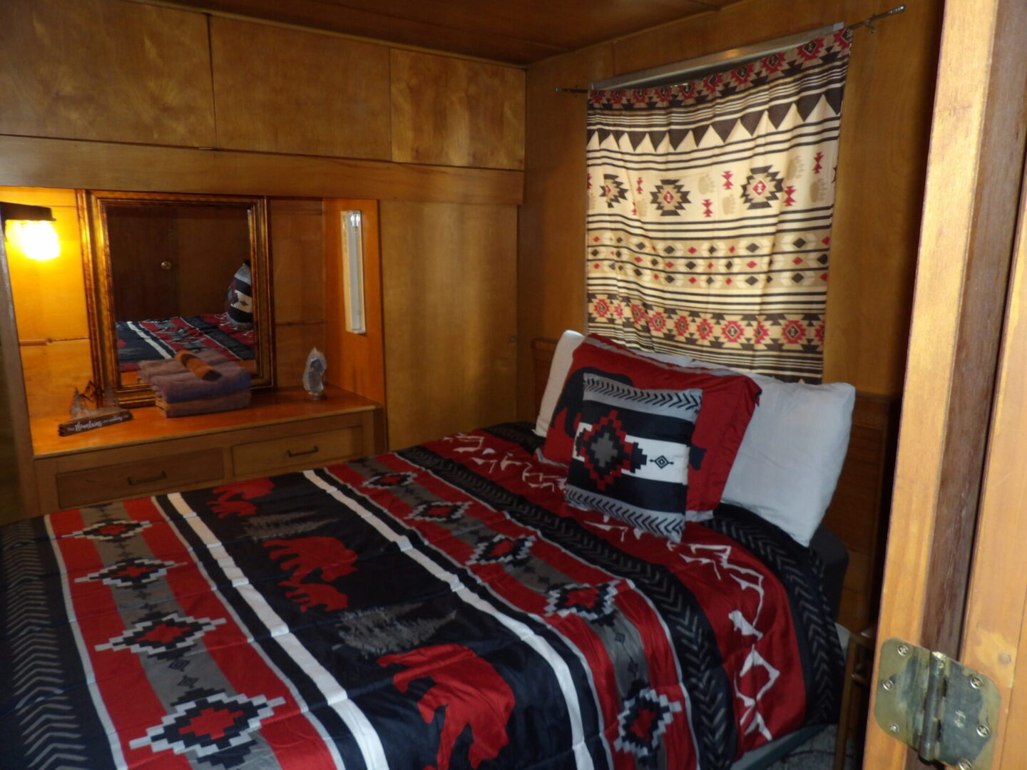 single bed with forest themed furnishing