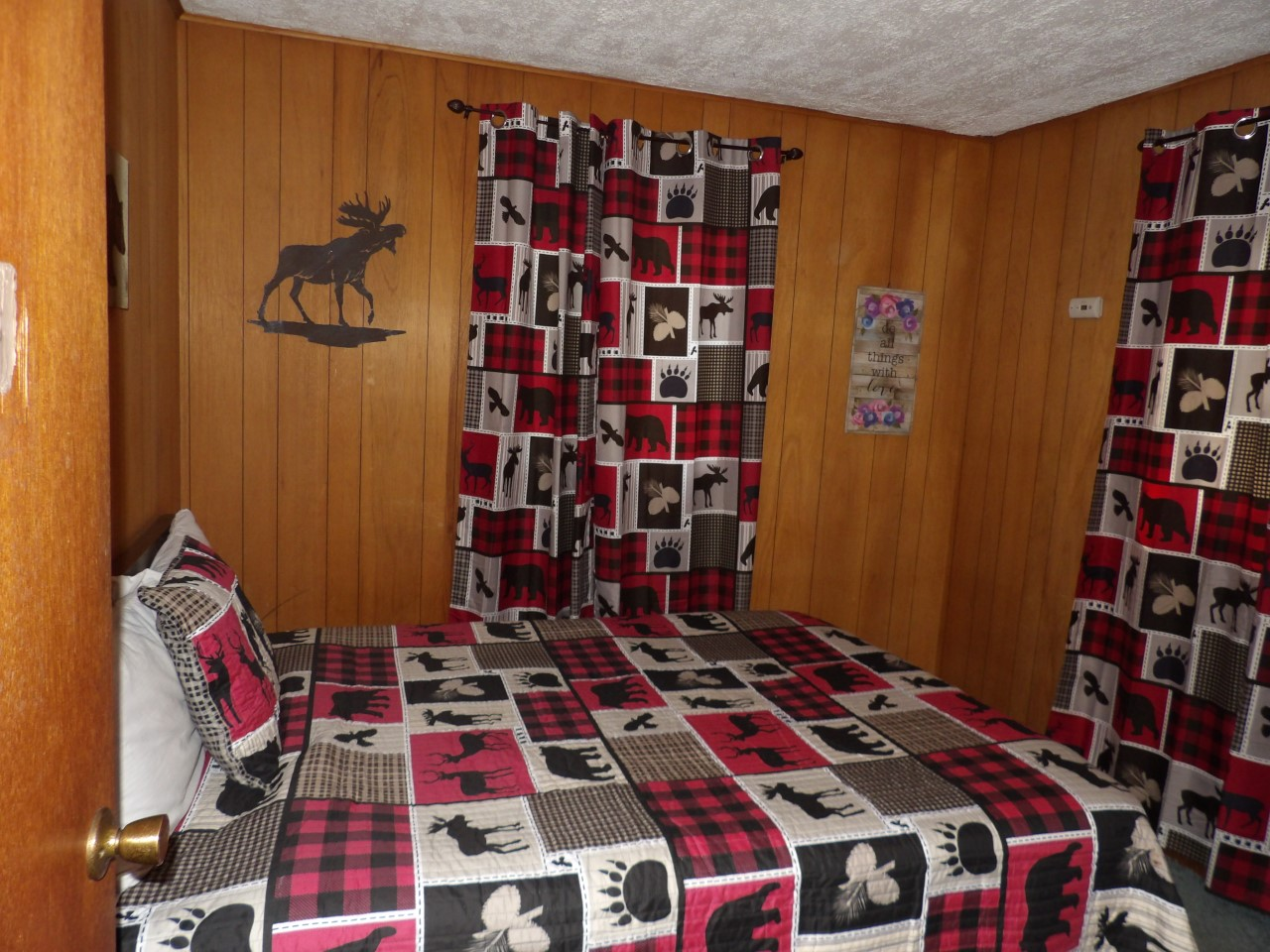 bed with moose and bear theme