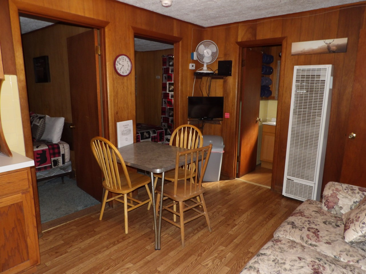 entrance to bedrooms with table and chairs