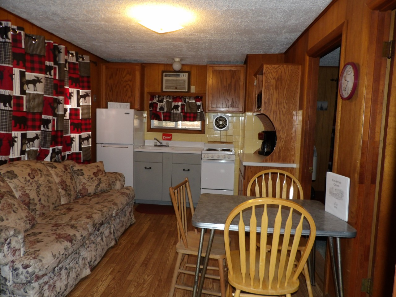 kitchen and dining room with sofa