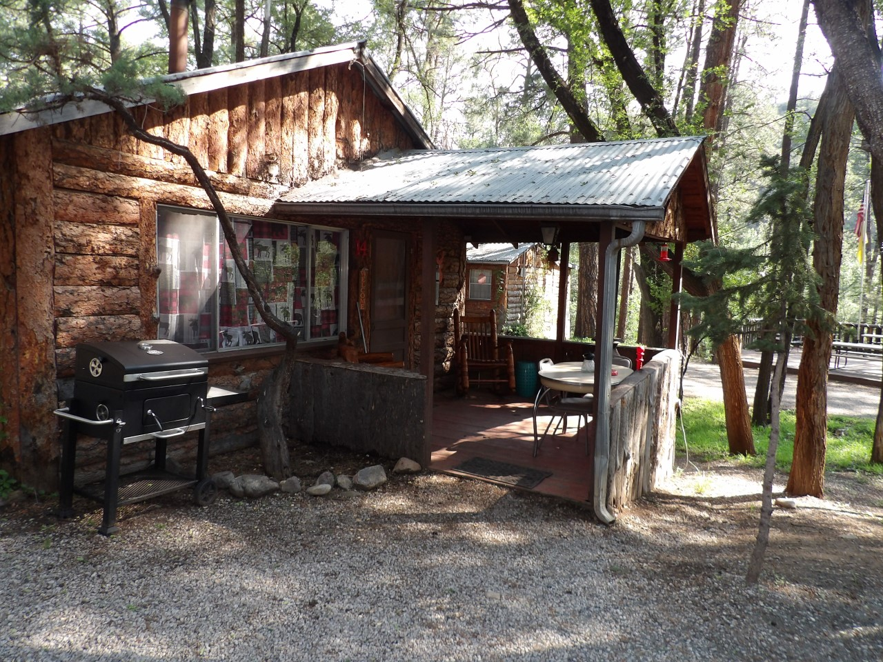 entrance to a cabin with grill
